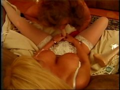 Sexy blonde gets her tits sucked and pussy fisted by shemale slut