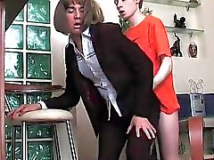 Redhead lad drills cute crossdresser
