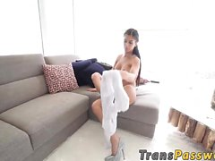 Stunning shemale Domino Presley pleasures herself on a sofa