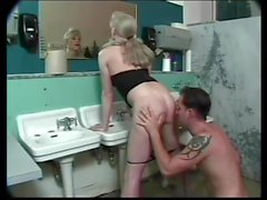 Brandy Scott fucks a guy in the bathroom.