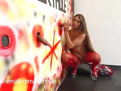 Sofia Has Her Shemale Mouth All Over Cock at the Glory Hole