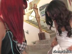 Red head TS Bailey bangs tranny babe Domino in hardcore anal action