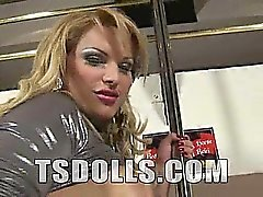 Watch as Nasty t-girl Carla Renata slowly strips on a bar